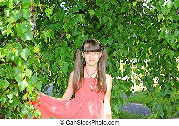 A girl under the birch tree