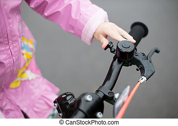 girl uses a signal on a child's Bicycle