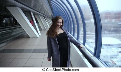 A girl walks by the windows
