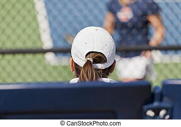A girl watching a tennis match