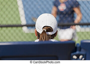 A girl watching a tennis match