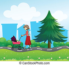 A girl with a baby stroller along the road