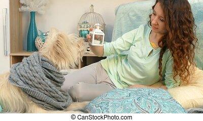 Girl showing dog Christmas toys