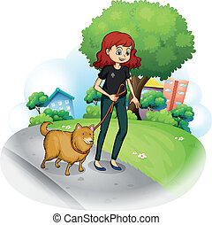 A girl with a dog walking along the street