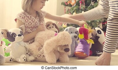A girl with a lot of stuffed toys