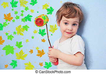 A girl with a roller does repair with leaves, collage - A...