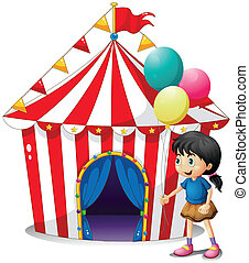 A girl with balloons in front of the circus tent