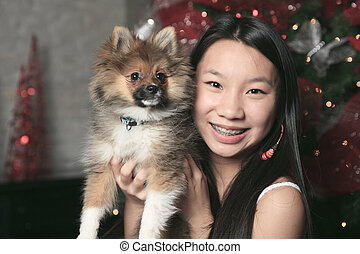 A Girl with dog inside his house