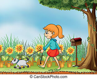 A girl with her pet in the garden