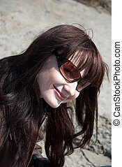 a girl with sun glasses