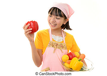 A girl with vegetables
