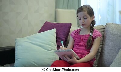 A girl writes draws in Notepad.