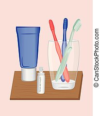 A glass and toothbrushes