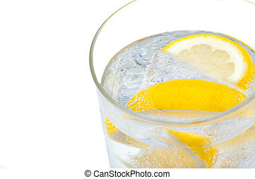 A glass beaker with crystal clear water, lemon and ice cubes.