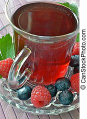 A glass cup of fruit tea