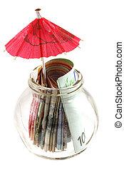 A glass jar contains money