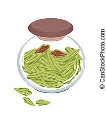 A Glass Jar of Fresh Cardamom Pods