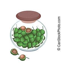 A Glass Jar of Ripe Macadamia Nuts