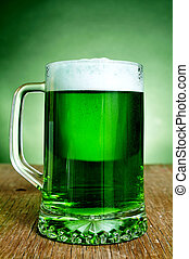 glass mug with dyed green beer - a glass mug with dyed green...