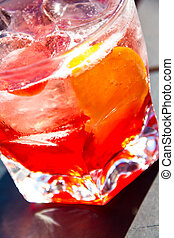 campari - a glass of campari on the rocks with a slice of ...