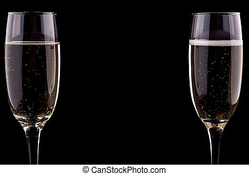 A glass of champagne on black background