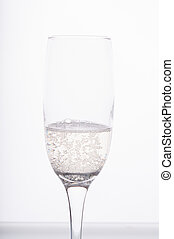 A glass of champagne on white background
