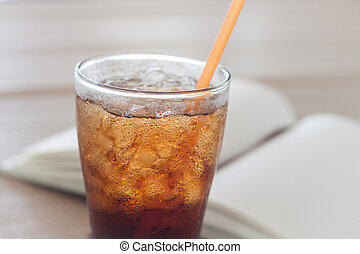 A glass of cola with ice