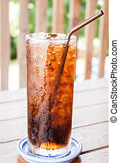 A glass of fresh cola drink with ice