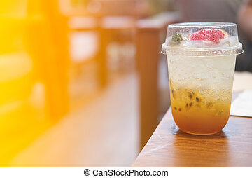A glass of fresh passion fruit juice mix with soda