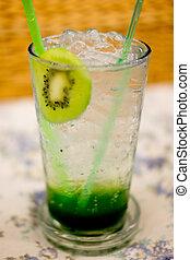 A glass of ice kiwi soda