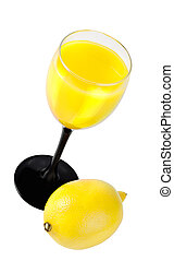 A glass of juice and lemon