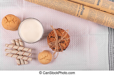 A glass of milk with cookies