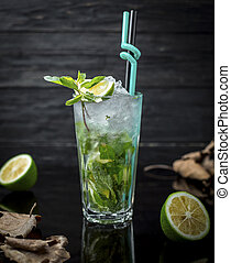 A glass of mojito with lime slice, fresh mint leaves