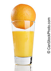 A glass of orange juice with an orange