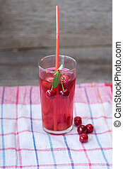 A glass of red cherry compot