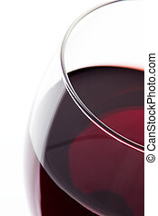 A glass of red wine. Detail on white