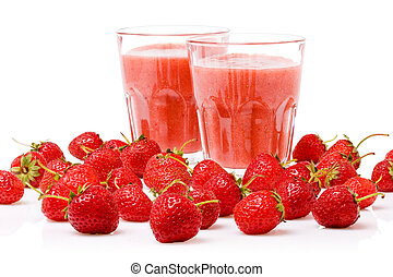 A glass of strawberry smoothie surrounded by fresh berries