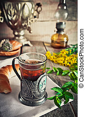 A glass of tea with thyme