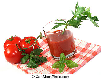 tomato juice - a glass of tomato juice with fresh herbs