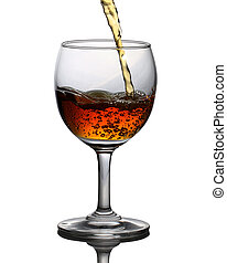 A glass of whiskey in which poured on a white background.