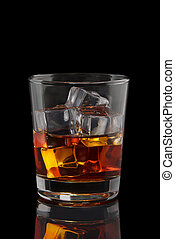 a glass of whiskey with ice on a black background