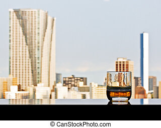 A glass of whisky with panoramic city view