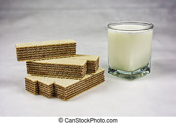 A glass of yogurt and wafers with chocolate filling