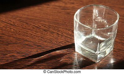 a glass standing on the table poured whiskey HD