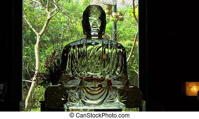 A glass statue of a deity - A steady, medium shot of a glass...