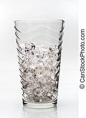 a glass with crashed ice isolated on white background