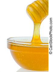 honey against white background - a glass with honey against ...