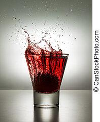 glass with ice and liquid splash