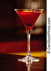 A glass with the red citrus cocktail