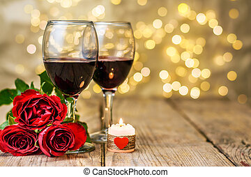 A glasses of wine, roses and burning candle - Valentine's...